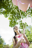 Little girl with pink balllons Stock Photography