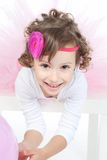 Little girl with pink balloon in studio Royalty Free Stock Image