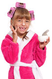 Little girl in pink bathrobe Stock Images