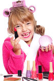 Little girl in pink bathrobe with curlers Stock Photos