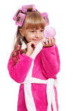 Little girl in pink bathrobe looking into a mirror Royalty Free Stock Photo