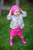 Little girl in pink boots Stock Photo