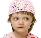 Little girl with pink cap - isolated on white Royalty Free Stock Photo