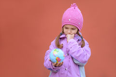 Little girl in pink coat holding Royalty Free Stock Image