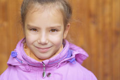 Little girl in pink coat Stock Photography