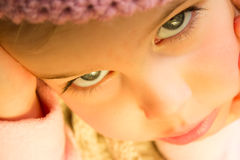 Little Girl in Pink Crochet Hat Close Up Royalty Free Stock Photography