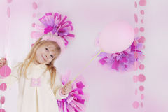 Little girl at pink decorated birthday party with balloon. Happy little girl at pink decorated birthday party with balloon Royalty Free Stock Image