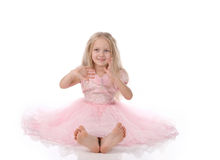 Little girl in a pink dres Stock Image