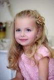 Little girl in a pink dress Stock Photos