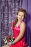 Little girl in pink dress with bouquet of flowers Royalty Free Stock Photography