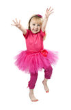 Little girl in a pink dress dancing in studio Stock Photos