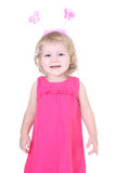 Little girl in pink dress with horns Stock Photography