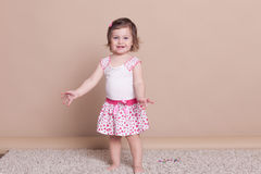 Little girl in a pink dress laughter smile. 1 Stock Image