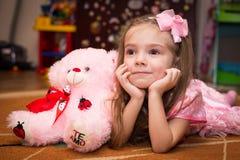 Little girl in a beautiful pink dress stock photos