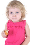 Little girl in pink dress with muffin Stock Images