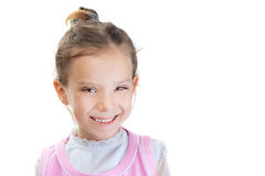 Little girl in pink dress sly smile Stock Photo