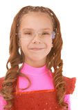 Little girl in pink dress sly smile Stock Photos