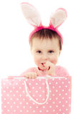 The little girl with pink ears bunny and bag. Stock Photography