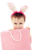 The little girl with pink ears bunny and bag. Royalty Free Stock Photos