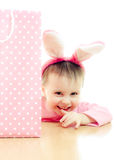 The little girl with pink ears bunny and bag. Royalty Free Stock Image