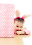 The little girl with pink ears bunny and bag. Royalty Free Stock Photo