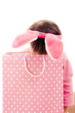 The little girl with pink ears bunny and bag. Stock Photos