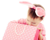 The little girl with pink ears bunny and bag. The little girl with pink ears bunny and bag on white background Stock Image