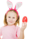 The little girl with pink ears bunny with an egg Royalty Free Stock Images