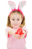 The little girl with pink ears bunny with an egg Stock Photography