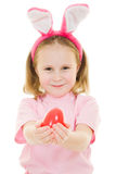 The little girl with pink ears bunny with an egg Royalty Free Stock Photos