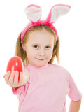 The little girl with pink ears bunny with an egg Royalty Free Stock Photography