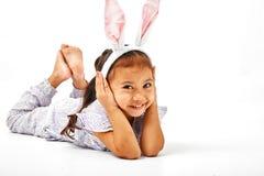 little girl with pink ears bunny stock photo