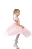 Little girl in a pink elegant dress Stock Photos