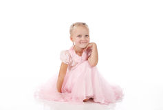 Little girl in a pink elegant dress Stock Photo