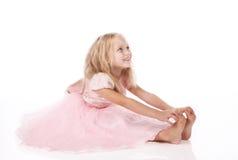 Little girl in a pink elegant dress Stock Photos