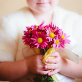 Little Girl With Pink Flowers Asters Stock Image