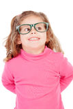 Little girl in pink with glasses looking up Stock Photos