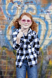 Little girl with pink glasses outdoors Royalty Free Stock Photography
