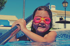Little girl in pink goggles Royalty Free Stock Photos