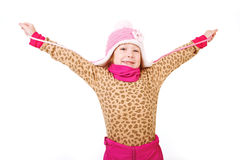 Little girl in a pink hat with arms outstretched Royalty Free Stock Image