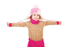 Little girl in a pink hat with arms outstretched Stock Photo