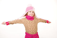 Little girl in a pink hat with arms outstretched Stock Photos