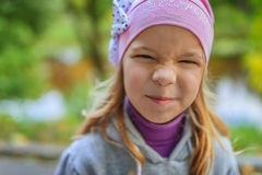 Little girl in a pink hat Stock Photo