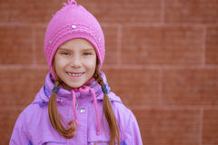 Little girl in pink hat and jacket Stock Image