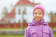 Little girl in pink hat and jacket Stock Photos