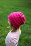 Little girl in pink hat and pink sweater Royalty Free Stock Photo