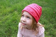 Little girl in pink hat and pink sweater Royalty Free Stock Image