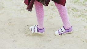 A little girl runs across the field stock footage