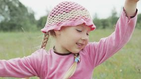 Little girl plays on the field stock footage