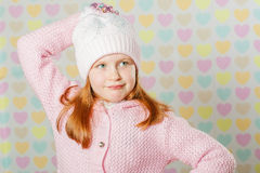 Little girl in a pink hat and a sweater Stock Photo